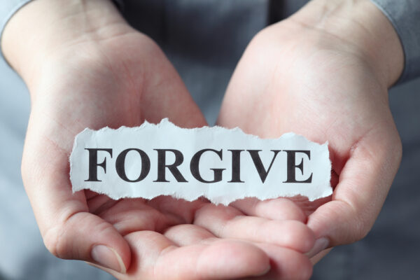 """Torn,Piece,Of,Paper,With,The,Word,""""forgive"""",In,The"""